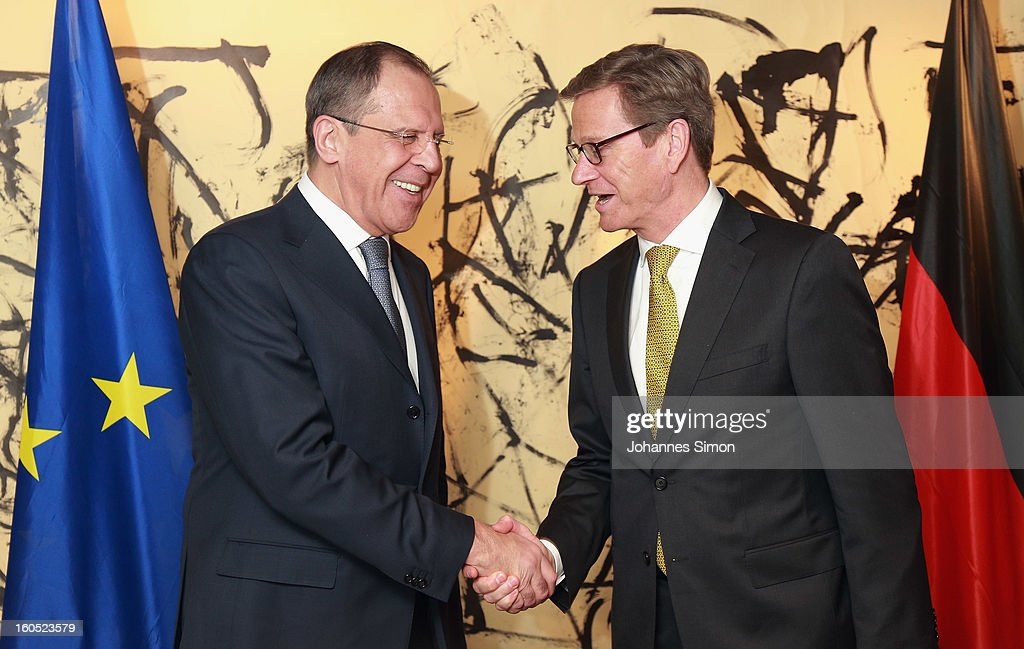 Russian minister of foreign affairs Sergey Lavrov (L) and German minister of foreign affairs Guido Westerwelle shake hands as they arrive for a bilateral meeting at Hotel Bayerischer Hof on February 2, 2013 in Munich, Germany. The Munich Security Conference brings together senior figures from around the world to engage in an intensive debate on current and future security challenges and remains the most important independent forum for the exchange of views by international security policy decision-makers.