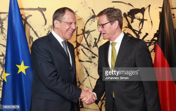 Russian minister of foreign affairs Sergey Lavrov and German minister of foreign affairs Guido Westerwelle shake hands as they arrive for a bilateral...