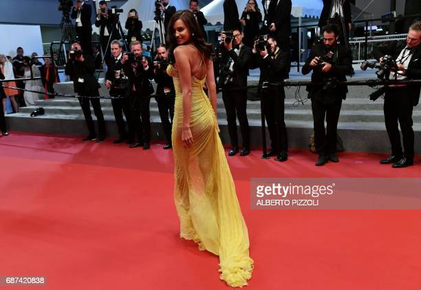 Russian model Irina Shayk poses as she arrives on May 23 2017 for the screening of the film 'Hikari' at the 70th edition of the Cannes Film Festival...