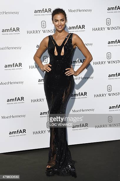 Russian model Irina Shayk poses prior to the Amfar dinner on the sidelines of the Paris fashion week on July 5 2015 in Paris AFP PHOTO / LOIC VENANCE