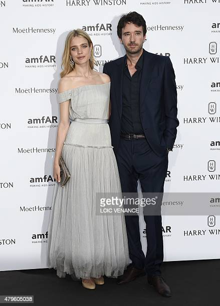 Russian model Natalia Vodianova and her companion French businessman Antoine Arnault pose prior to the Amfar dinner on the sidelines of the Paris...