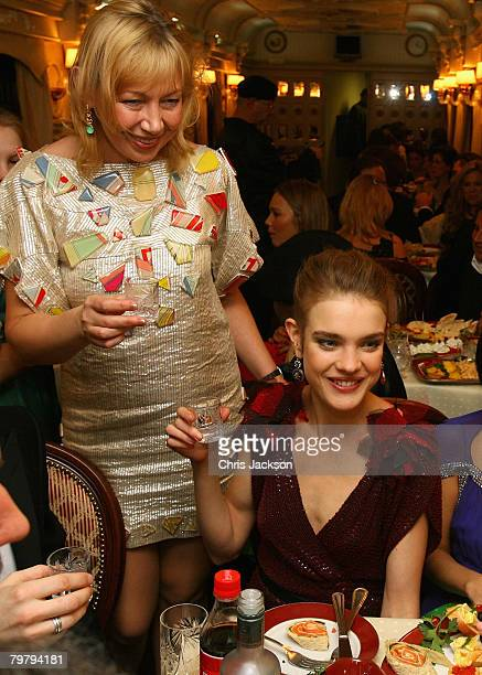 Russian model Natalia Vodianova drinks vodka with her mother Larisa makes a speech during the 'Love Ball' at the Tsaritsino Palace Estate on February...