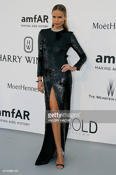Russian model Natasha Poly poses as she arrives for the amfAR 22st Annual Cinema Against AIDS during the 68th Cannes Film Festival at Hotel du...