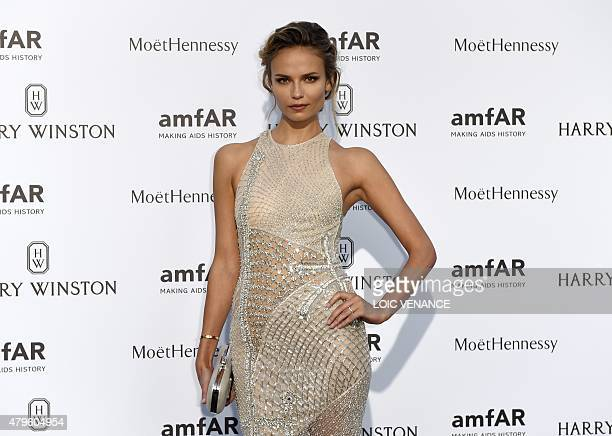 Russian model Natasha Poly poses prior to the Amfar dinner on the sidelines of the Paris fashion week on July 5 2015 in Paris AFP PHOTO / LOIC VENANCE