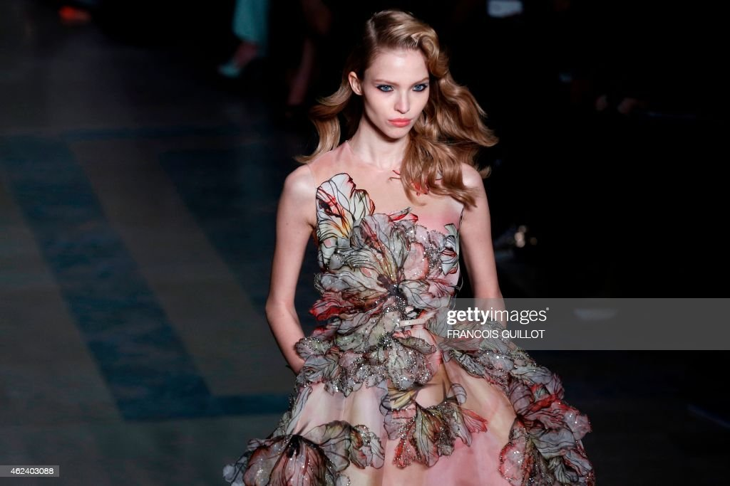 Russian model Sasha Luss presents a creation by Elie Saab during the 2015 Haute Couture SpringSummer collection fashion show on January 28 2015 in...