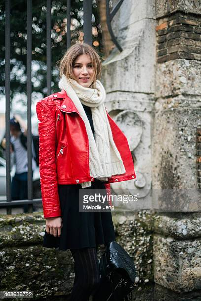 Russian model Valery Kaufman exits the Alberta Ferretti show in a Versace jacket on Day 1 of Milan Fashion Week FW15 on February 25 2015 in Milan...