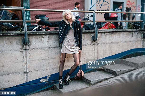 Russian model Zlata Semenko strikes a pose in a black leather jacket a velvet dress ripped tights and black boots after the Fausto Puglisi show...