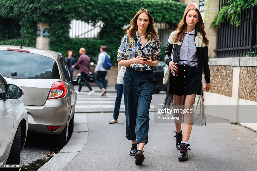 Russian models Odette Pavlova and Sofia Tesmenitskaya after the Christian Dior show on Avenue Montaigne on July 04 2016 in Paris France Odette wears...