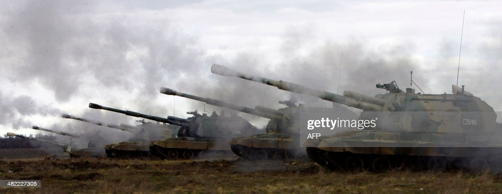 Russian MstaS selfpropelled howitzers fire during military exercises in the southern Russia's Volgograd region on April 2 2014 Russian troops...