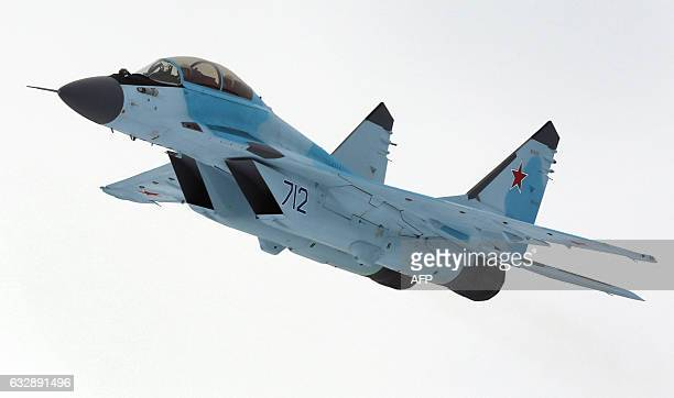 A Russian multipurpose jet fighter MiG35 flies during its presentation at the MiG plant in Lukhovitsy on January 27 2017 The MiG35 jet fighter is a...