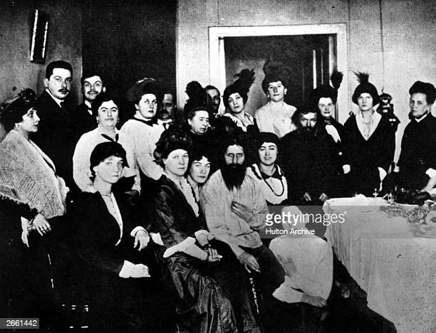 Russian mystic and selfstyled holy man Grigory Yefimovich Rasputin surrounded by his court followers Amongst them are Sana Pistolkors A E Pistolkors...