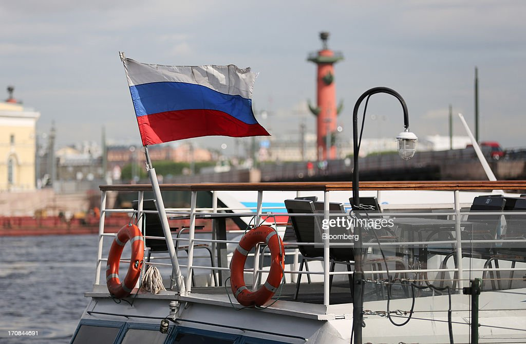 A Russian national flag flies from a passenger boat on the Neva river ahead of the St. Petersburg International Economic Forum 2013 (SPIEF) in St. Petersburg, Russia, on Wednesday, June 19, 2013. The Russian Deputy Prime Minister Igor Shuvalov told the conference that the country's World Trade Organization accession negotiations could be further delayed unless several remaining disputed matters are solved. Photographer: Andrey Rudakov/Bloomberg via Getty Images