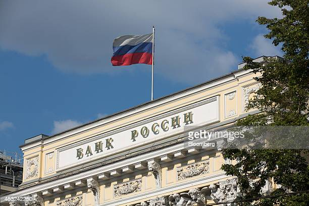 A Russian national flag flies from the roof of Russia's central bank also known as Bank Rossii in Moscow Russia on Tuesday Aug 5 2014 Russian...