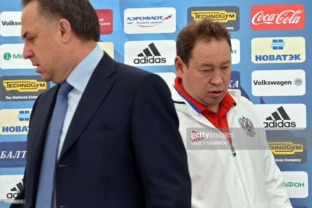 Russian national football team head coach Leonid Slutsky (R) and the country's sports minister Vitaly Mutko attend a press conference at Moscows Sheremetyevo airport on May 24, 2016. Russias footballers departed from Moscow to Switzerland where they are scheduled to play two friendly games before their trip to France where they are to take part in the UEFA European Championship. / AFP / VASILY