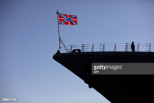 A Russian Navy flag floats over the Pyotr Velikiy Russian nuclearpowered missile cruiser docked in the Cypriot port of Limassol on February 12 2014...