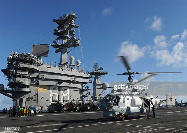 A Russian Navy KA-27 Helix helicopter lands aboard USS Nimitz.