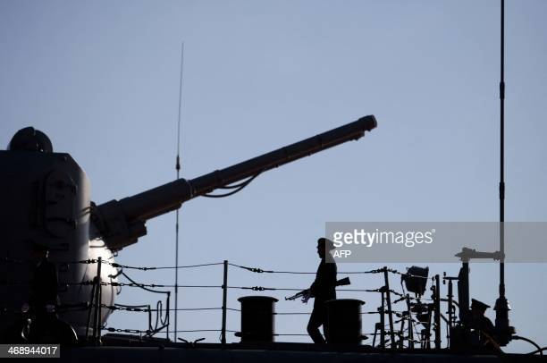 A Russian Navy member stands guard on the deck of the Pyotr Velikiy Russian nuclearpowered missile cruiser docked in the Cypriot port of Limassol on...