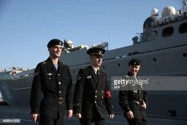 Russian Navy members patrol the dock where the Pyotr Velikiy Russian nuclearpowered missile cruiser is moored in the Cypriot port of Limassol on...