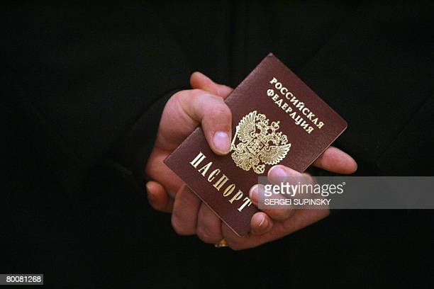 A Russian Navy sailor holds his passport while waiting in line to vote at a polling station in Sevastopol military base of Russian Black Sea Fleet in...
