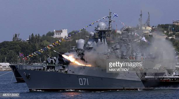 A Russian Navy ship fires missiles during Navy Day celebrations in the Crimean city of Sevastopol on July 26 2015 AFP PHOTO / MAX VETROV