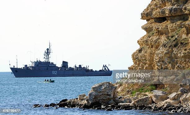 A Russian Navy ship is docked in the bay of Sevastopol on March 5 2014 Russia said on March 5 it has no authority over proMoscow forces that have...