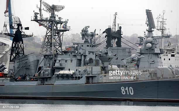 A Russian Navy ship is moored in Sevastopol bay on March 7 2014 Trailed by a convoy of cars waving the Ukrainian flag and honking their horns two...