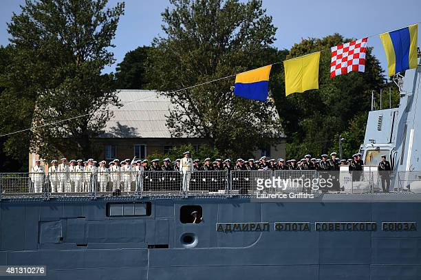 Russian Navy troops stand to attention as the Krusenstern a four mast barque ship built in 1925 passes their boat during a media tour of Russia 2018...
