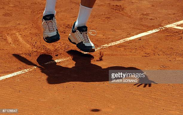 Russian Nikolay Davydenko serves to his opponent Serbian Viktor Troicki during their match of the ATP Madrid Open claycourt tournament on May 12 2009...