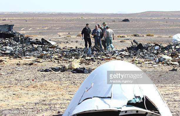Russian officials inspect the crash site of Russian Airliner in Suez Egypt on November 01 2015 A Russian Airbus321 airliner with 224 people aboard...