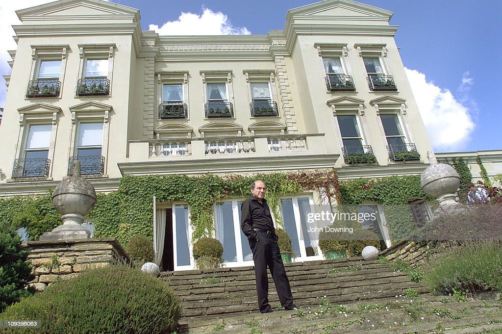 Russian oligarch and businessman Boris Berezovsky outside his house in Egham, Surrey, where he lives in exile, 24th August 2002