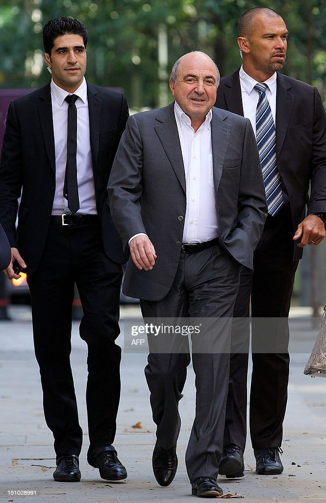 Russian oligarch Boris Berezovsky (C) arrives at London's High Court in central London, on August 31, 2012. Berezovsky lost his long-running battle in London High Court with fellow tycoon Roman Abramovich on Friday. Berezovsky, 66, was seeking more than £3 billion ($4.75 billion, 3.8 billion euros) in damages after accusing the 45-year-old owner of Chelsea football club of blackmail, breach of trust and breach of contract.