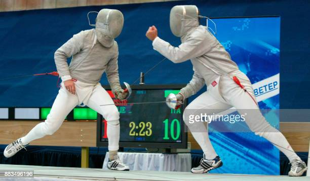 Russian Olympic champion Serguei Charikov fights with Italian Aldo Montana during the final team match of Fencing Euro Champion in Moscow 07 July...