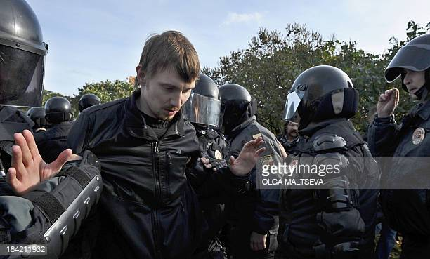 Russian OMON riot police officers detain a gay rights activist during a gay pride event in Saint Petersburg on October 12 2013 Russian police...