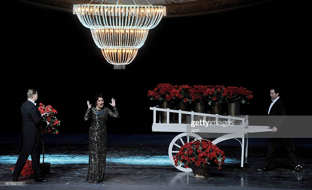 Russian opera singer Anna Netrebko (2nd L) performs during a dress rehearsal on May 1, 2013 on the eve of the Grand gala dedicated to the opening of the new stage Mariinsky II theatre in St. Petersburg. Russia's famous Mariinsky theatre in Saint Petersburg was to inaugurate a new ballet and opera house on May 2 in an event coinciding with the 60th birthday of its hugely ambitious and well-connected director Valery Gergiev. AFP PHOPTO / OLGA MALTSEVA