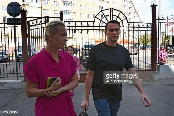 Russian opposition leader Alexei Navalny accompanied by his wife Yulia arrives at Moscow's Simonovsky district court for a hearing over repeatedly...