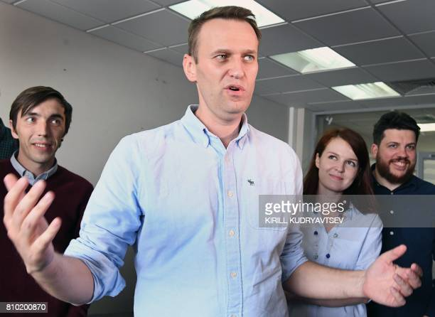Russian opposition leader Alexei Navalny gestures as he makes a statement for media in his office in Moscow on July 7 shortly after being released...