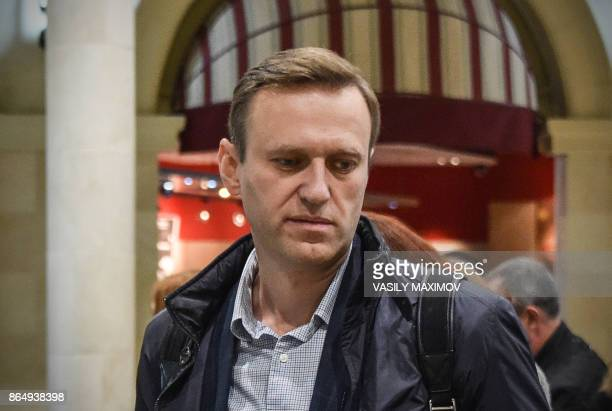 Russian opposition leader Alexei Navalny looks on at the Domodedovo airport hall shortly after being released in Moscow on October 22 2017 Alexei...