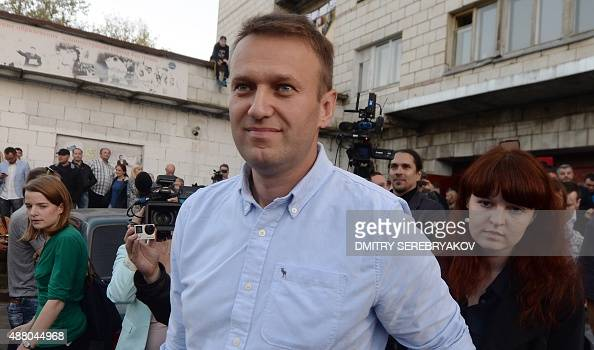 Russian opposition leader Alexei Navalny looks on near the Open Russia movement office during Russian regional elections in the town of Kostroma some...