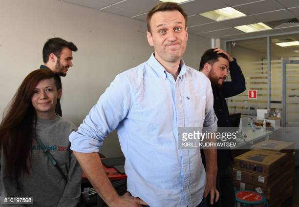 Russian opposition leader Alexei Navalny reacts as he makes a statement for media in his office in Moscow on July 7 shortly after being released from...