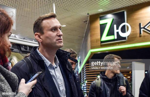 Russian opposition leader Alexei Navalny walks along Domodedovo airport hall shortly after being released in Moscow on October 22 2017 Alexei Navalny...