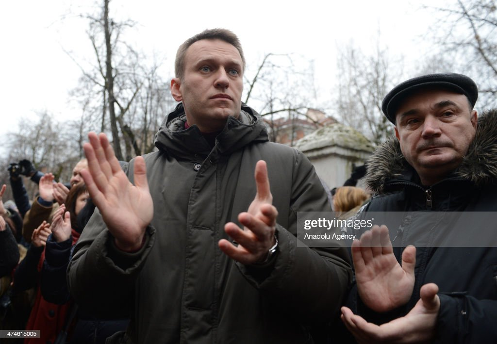 Russian opposition leader and lawyer Alexei Navalny (C) applauds during the ''Bolotnaya trial'' in Moscow on February 24, 2014. The trial about the protest at least 80 wounded and 400 custody that was held on the eve of President Vladimir Putin's May 7, 2012 in Moscow, Russia.