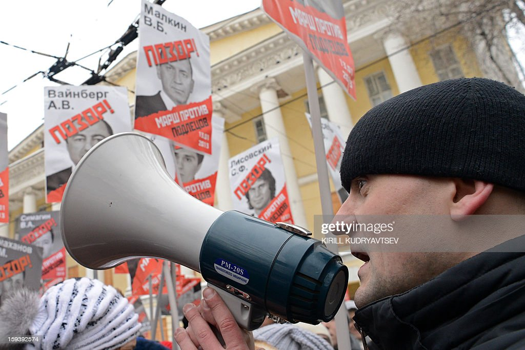 Russian opposition leader Sergey Udaltsov uses a megaphone on January 13, 2013 during a rally of at least 20,000 Russian opposition supporters n the Boulevard Ring in the center of Moscow against a Kremlin law that banned US adoptions of Russian orphans. The protest dubbed 'the March Against Scoundrels' was aimed at naming and shaming the lawmakers who fast-tracked the anti-adoption bill through the lower house parliament, the State Duma.