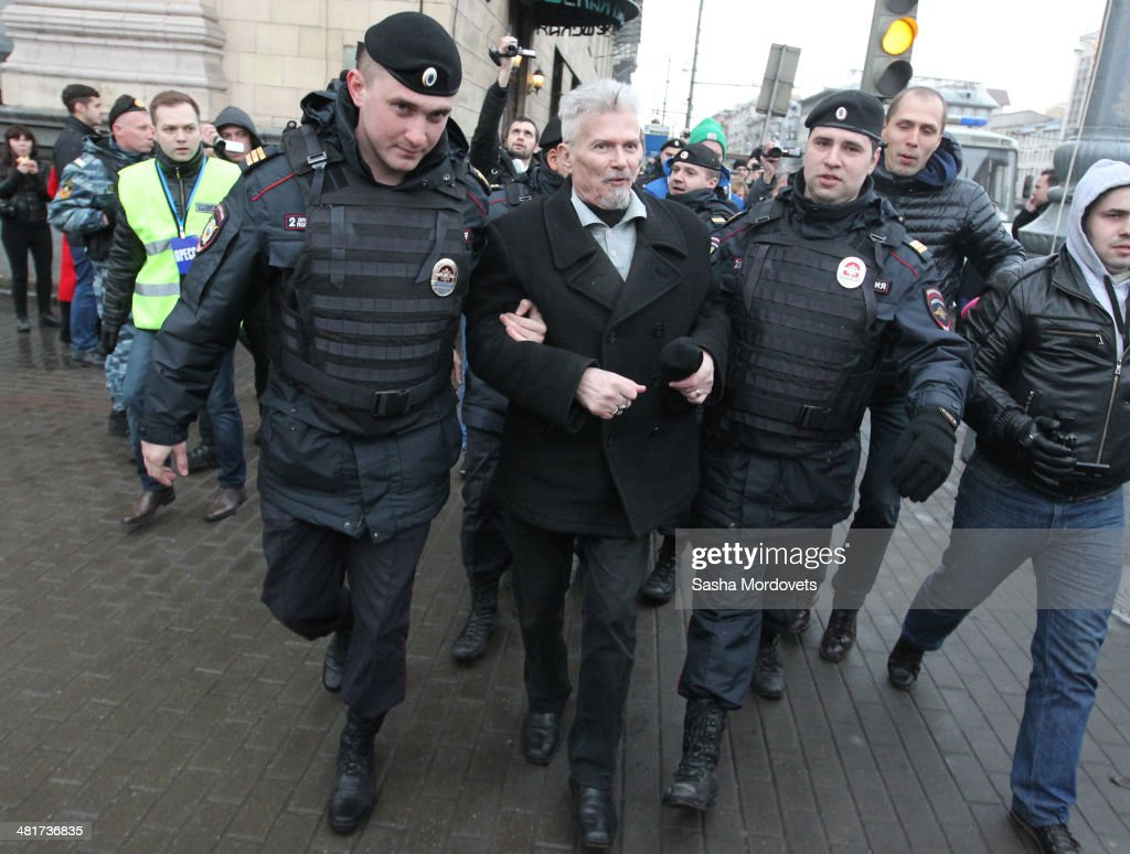 Russian opposition politician and leader of banned National Bolshevik Party Eduard Limonov is detained by polce during an unsanctioned rally at the Triumphalnaya Square on March 31, 2014 in Central Moscow, Russia. Limonov's party have supported Putin's policies in Ukraine and the annexation of Crimea, but are also demanding the annexation of Donetsk and other regions of Eastern Ukraine. Dozens of activists, including Limonov, were detained by riot police during this rally.