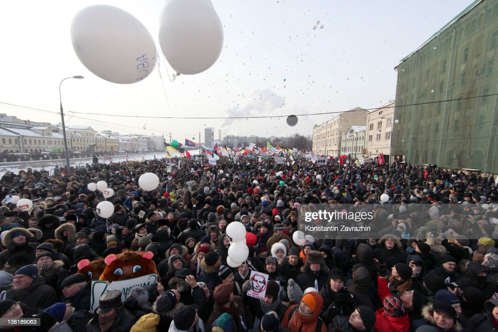 Russian oppostion activists take part in a rally and march to Bolotnaya Square on February 4, 2012 in Moscow, Russia. Demonstrators braved temperatures as low as -20 degrees celsius as they took to the streets exactly one month before the presidential elections in protest against Vladimir Putin's efforts to return to the Kremlin for an unprecedented third term as President.