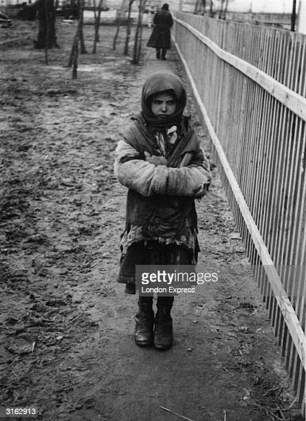 Russian orphan in Kiev during the famine Her parents died from starvation and she survives on charity from a neighbour