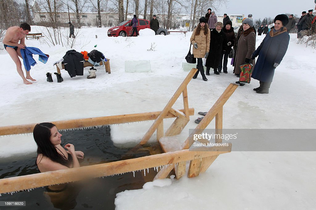 A Russian Orthodox bathes in the icy-cold water of a lake during Orthodox Epiphany celebrations on January 19, 2013 in the Yaroslavl region, 260 km north of Moscow, Russia. People all over Russia are taking part in a baptism ceremony, one the biggest events in the Christian Orthodox calendar.