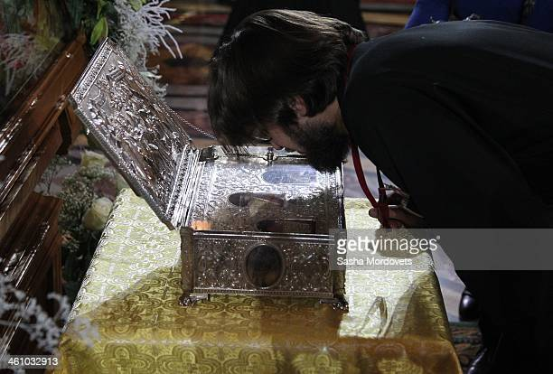 Russian Orthodox believer kisses the Gifts of the Magi box during the Christmas Mass in the Christ the Saviour Cathedral in the early morning of...