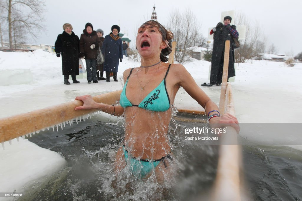 A Russian Orthodox believer reacts to the water temperature during Orthodox Epiphany celebrations in the icy-cold water of the lake in Yaroslavl region, 260 km. North of Moscow on January, 19, 2013 in Russia. People all over Russia are taking part in a baptism ceremony, one the biggest events in the Christian Orthodox calender.
