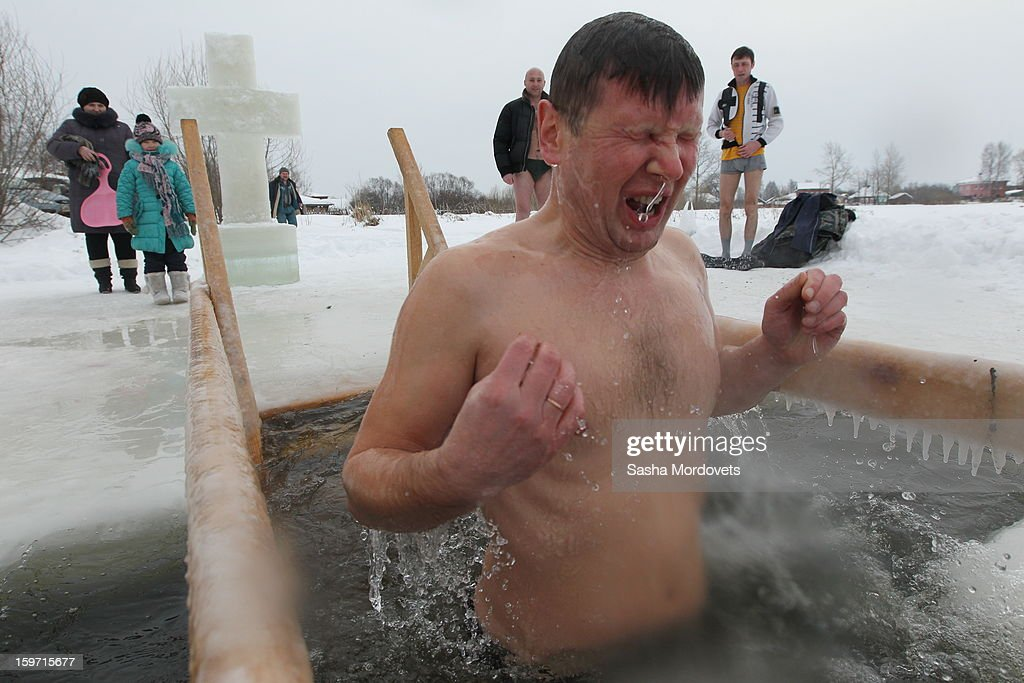 A Russian Orthodox believer reacts to the water temperature during Orthodox Epiphany celebrations in the icy-cold water of the lake in Yaroslavl region, 260 km. North of Moscow on January, 19, 2013 in Russia. People all over Russia are taking part in a baptism ceremony, one the biggest events in the Christian Orthodox calendar.