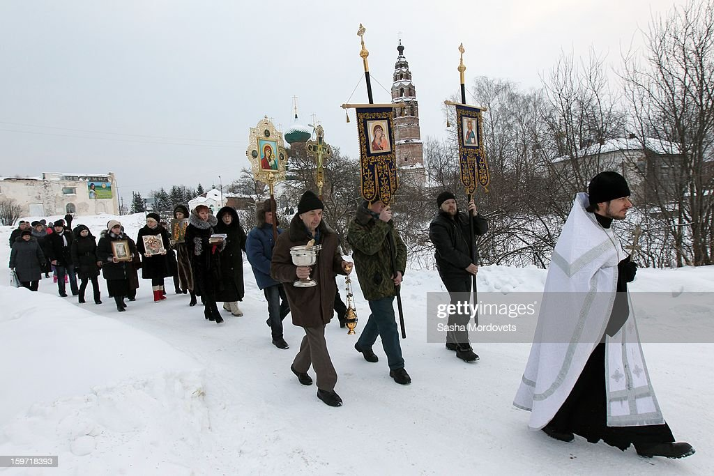 Russian Orthodox believers attend an Orthodox Epiphany mass on January 19, 2013 in the Yaroslavl region, 260 km north of Moscow, Russia. People all over Russia are taking part in a baptism ceremony, one the biggest events in the Christian Orthodox calendar.